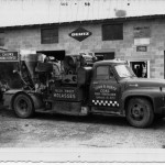 A feed truck, powered by a Deutz engine, is displayed in front of the original shop in Hatville.